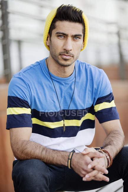 Portrait of fashionable young man wearing cap an striped t-shirt — Stock Photo