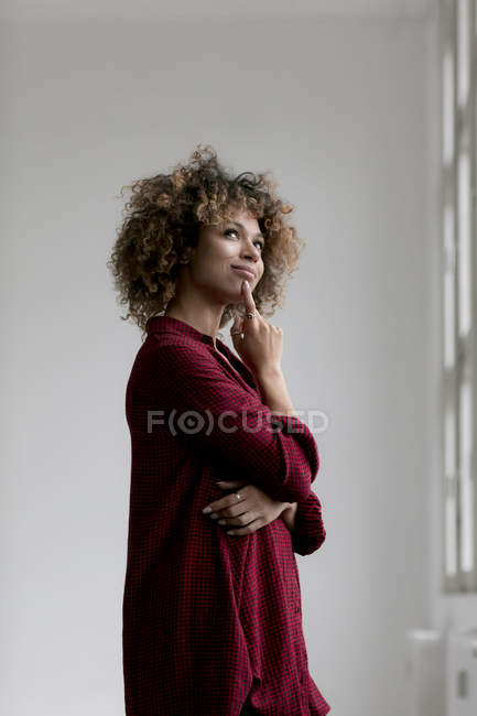 Portrait of thinking woman and looking up — Stock Photo
