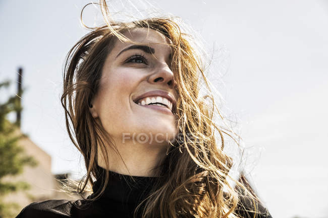 Portrait of happy woman with blowing hair — Foto stock