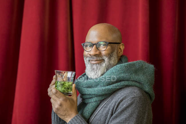 Portrait of happy african american man with glass of tea — Stock Photo