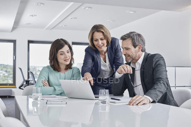 Business people having a meeting in office with laptop — Stock Photo