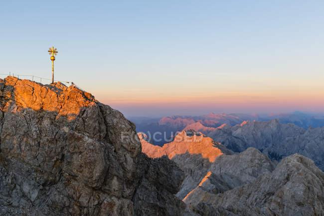 Austria, Germany, Bavaria, Zugspitze, summit cross in the evening light — Stock Photo