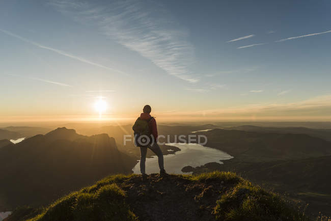 Austria, Salzkammergut, Hiker standing on summit, looking at view — Stock Photo