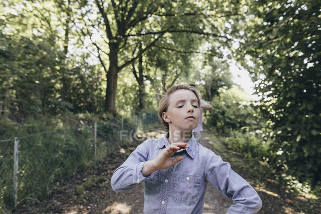 Boy posing on forest path — Stock Photo