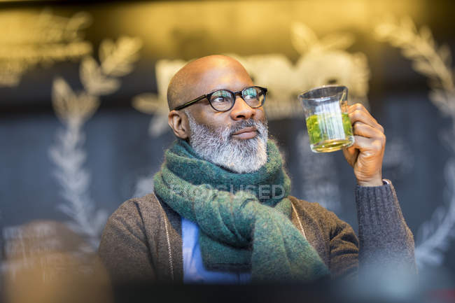 Portrait of african american man with glass of tea — Stock Photo