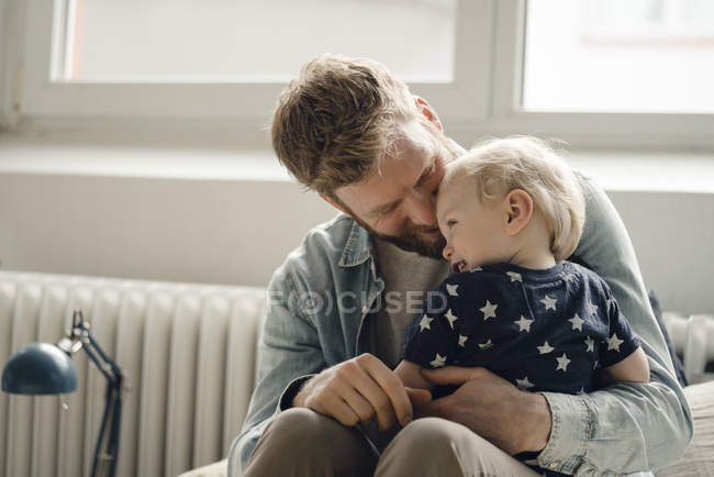 Father spending time with his son at home — Stock Photo