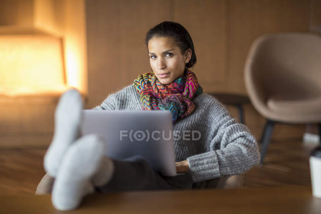 Portrait of fashionable young woman with laptop — Stock Photo