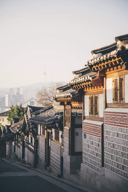South Korea, Bukchon Hanok Village, street with traditional houses, Seoul Tower in the background — Stock Photo