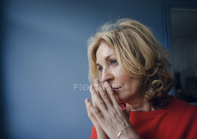 Portrait of thoughtful senior woman — Stock Photo