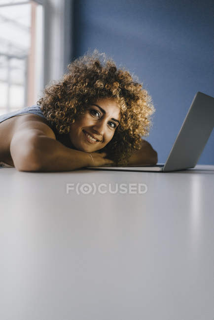 Woman working overtime in her start-up business — Stock Photo