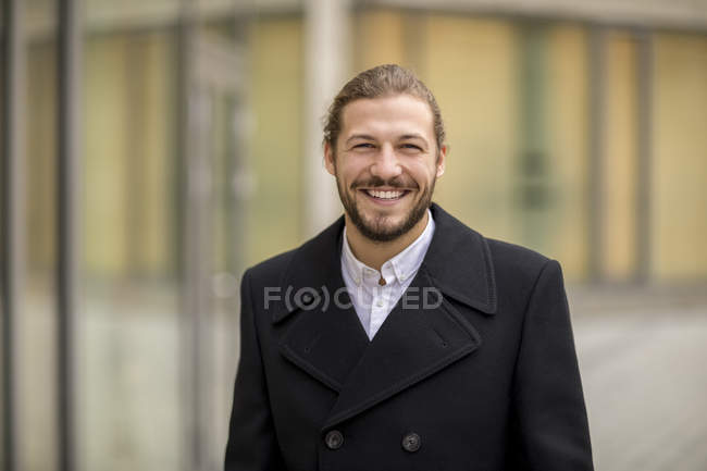 Portrait of laughing man in autumn — Stock Photo
