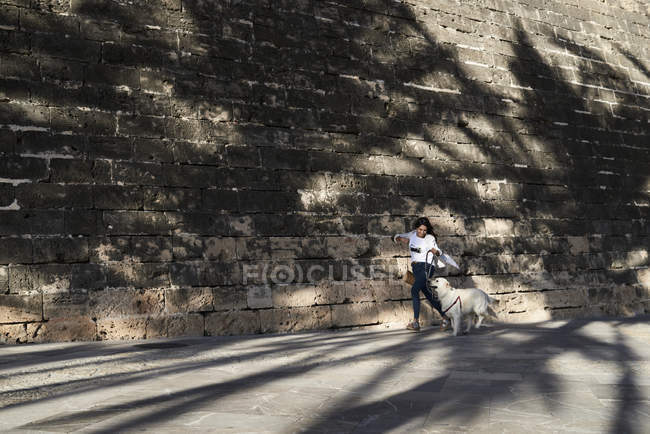 Young woman having fun with her dog — Photo de stock