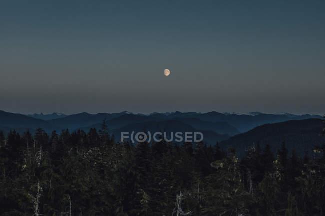 Canada, British Columbia, Skeena-Queen Charlotte A, Kaien Island, Prince Rupert, Mount Hays, moon at night — Stock Photo