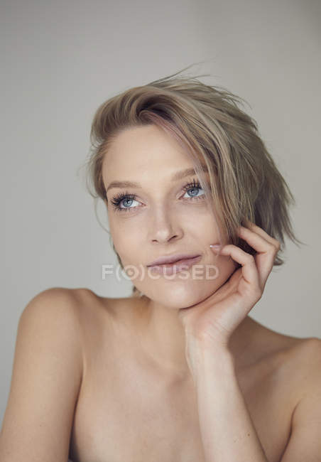 Portrait of beautiful blond woman looking away — Stock Photo