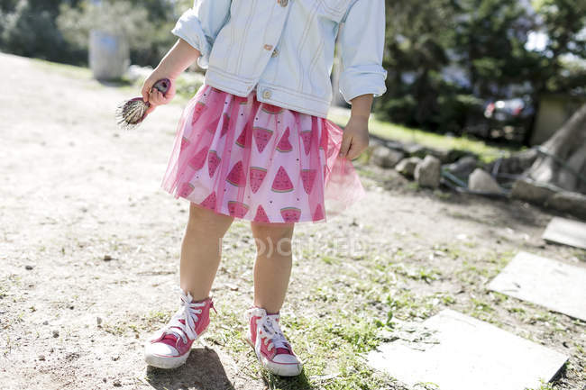 Little girl wearing fashionable skirt, partial view — Stock Photo