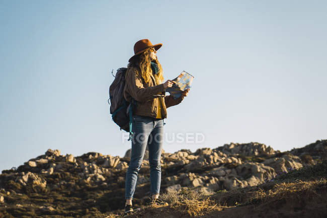 Italy, Sardinia, woman holding map on a hiking trip — Stock Photo