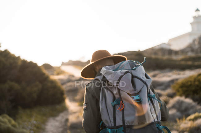 Italy, Sardinia, back view of hiker with backpack — Stock Photo