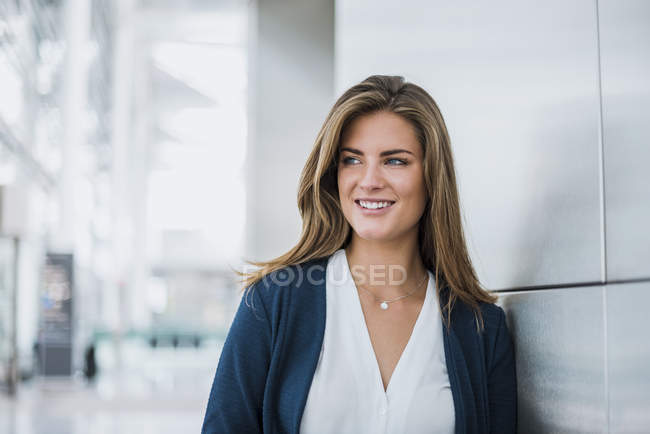 Portrait of smiling young businesswoman looking around — Stock Photo