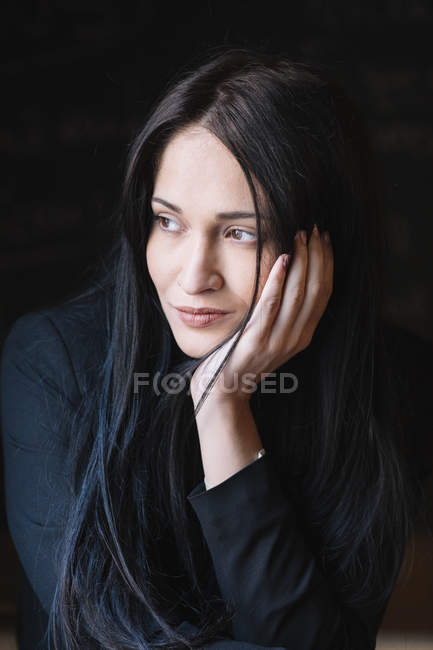 Portrait of thoughtful long-haired young woman — Stock Photo