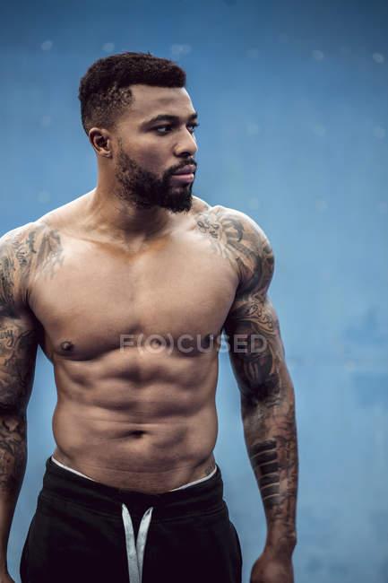 Portrait of tattooed physical athlete — Stock Photo