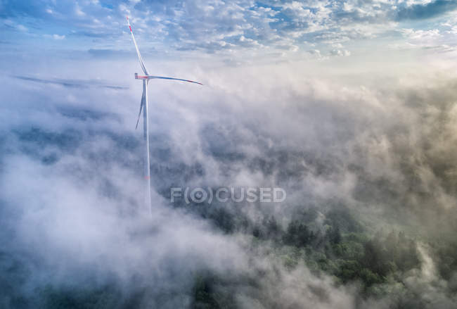 Germany, Baden-Wuerttemberg, Schurwald, Aerial view of wind wheel and morning fog — Stock Photo