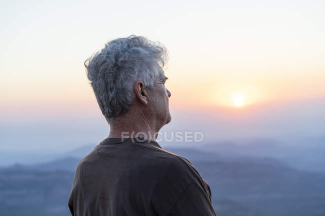 Spain, Catalonia, Man looking at sunset in the mountains — Stock Photo