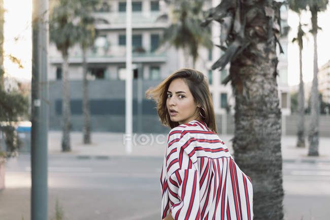 Portrait of woman wearing striped shirt — Stock Photo