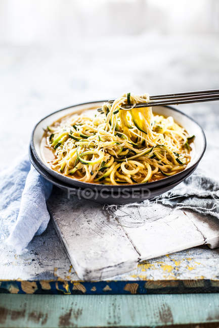 Asian style noodle soup with glas noodles and zoodles in red curry broth — Stock Photo