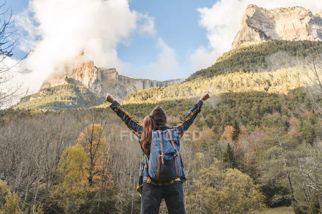 Spain, Ordesa and Monte Perdido National Park, back view of happy woman with backpack looking at view — Stock Photo