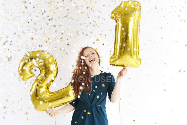 Happy young woman with golden  balloons celebrating birthday — Stock Photo