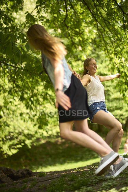 Two best friends dancing together in nature — Stock Photo