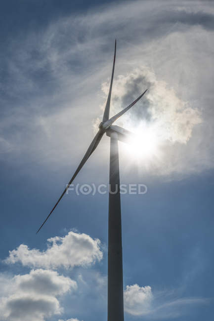 Wind turbine in backlight — Stock Photo