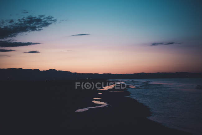 Espagne, côte au coucher du soleil — Photo de stock