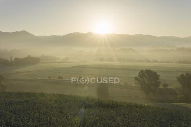 Italy, Tuscany, Borgo San Lorenzo, sunrise above rural landscape — Stock Photo