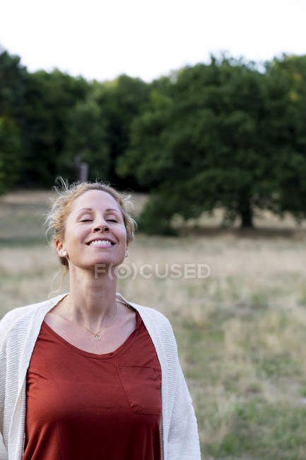 Portrait of happy woman enjoying nature — Stock Photo