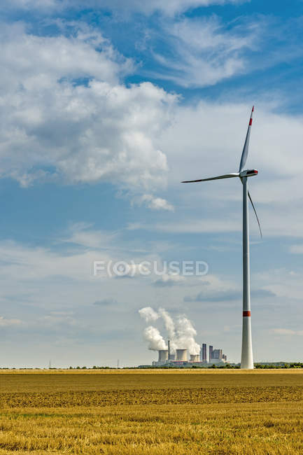 Germany, Grevenbroich, Neurath power station and wind turbine — Stock Photo