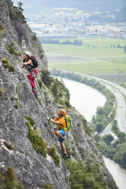 Austria, Tyrol, two rock climbers in Martinswand — Stock Photo