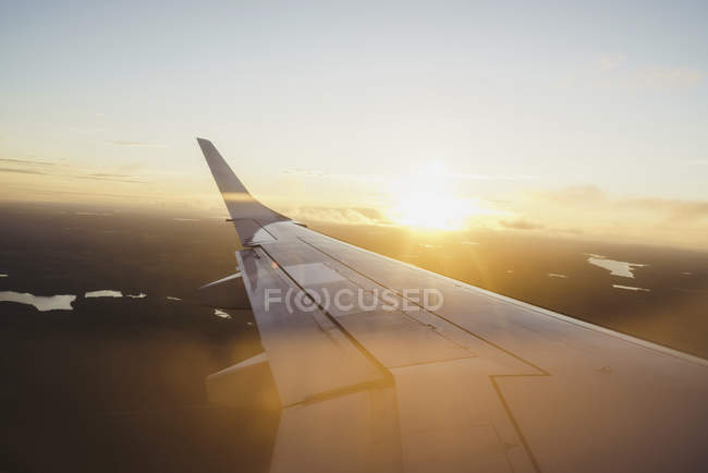 Wing of a plane at sunset — Stock Photo