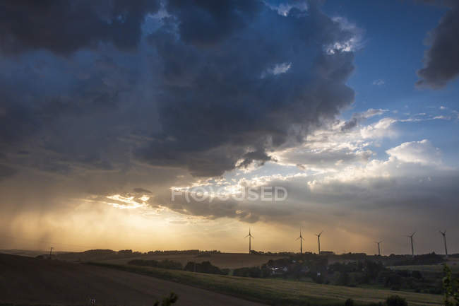 Germany, Lausitz, wind wheels and  thundercloud — стоковое фото
