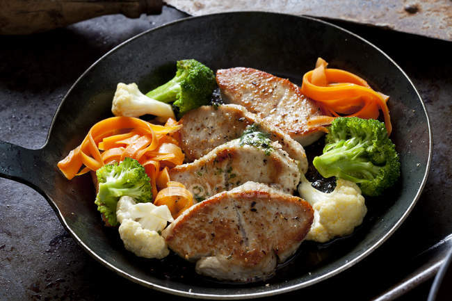 Fillet of turkey and vegetables in pan — Stock Photo