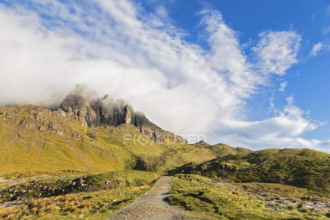 UK, Scotland, Inner Hebrides, Isle of Skye, Trotternish, clouds around The Storr, trail towards observation point — Stock Photo
