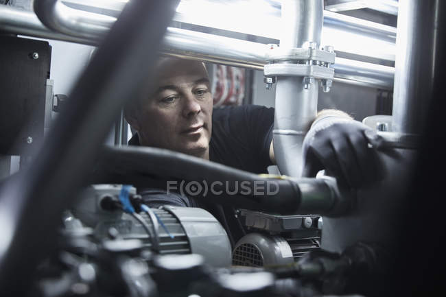 Worker checking hose line — Stock Photo