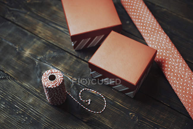 Red-white packing material on dark wood — Stock Photo