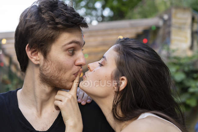 Portrait of young couple facing each other — Stock Photo