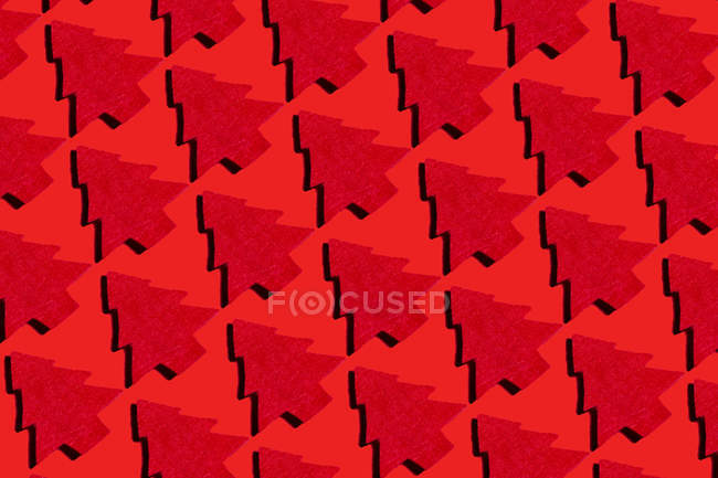 Red Christmas trees on red ground, 3D Rendering — Stock Photo
