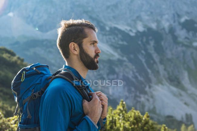 Austria, Tyrol, Hiker with backpack hiking in mountains — Stock Photo