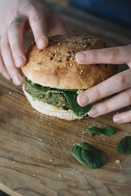 Woman holding homemade vegan burger — Photo de stock
