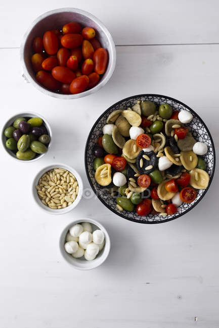 Mediterranean orecchiette with tomato, olives, mozzarella — Stock Photo