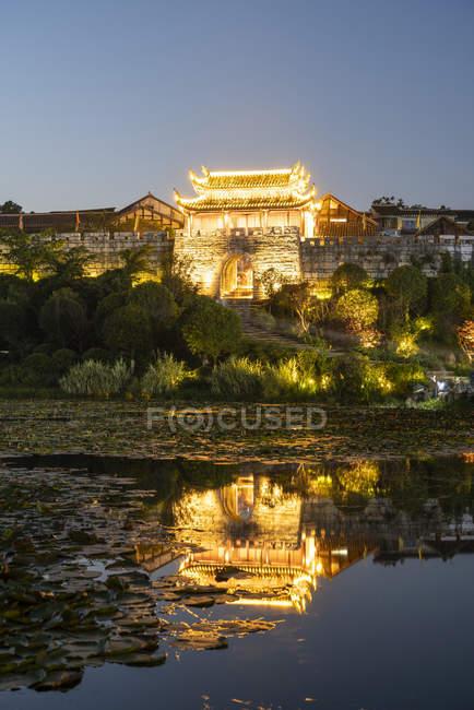 China, Qinyang illuminated building in the evening — Stock Photo