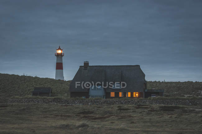 Germany, Schleswig-Holstein, Sylt, Ellenbogen, lighthouse List Ost in the evening — Stock Photo